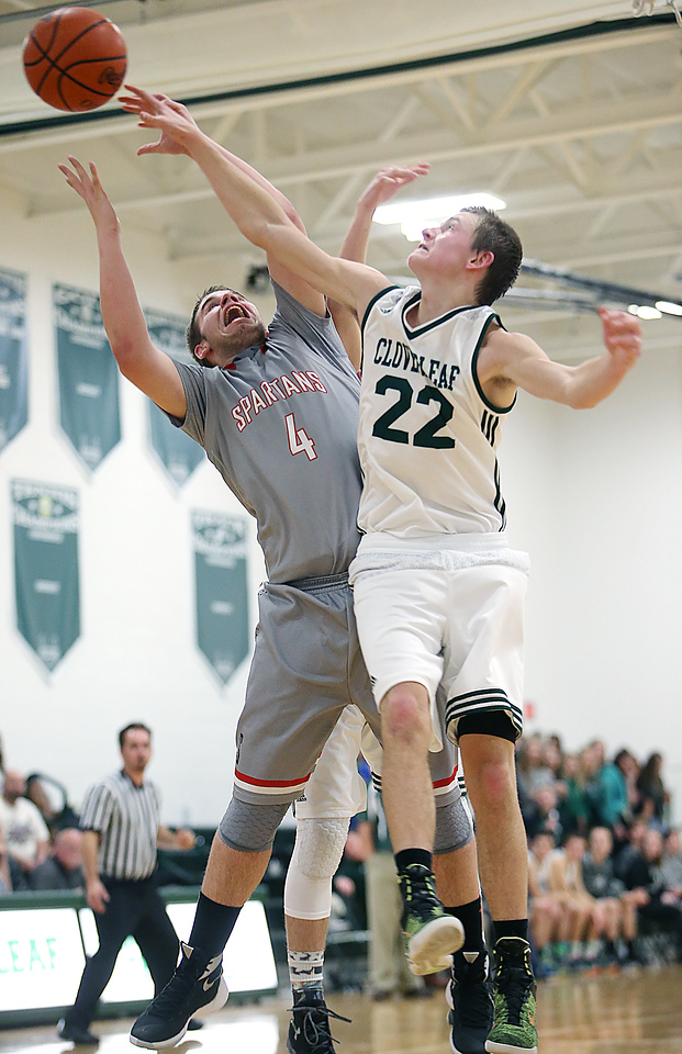 Cloverleaf's Ryan Gutschow fights for a rebound against Springfield's Jordan McLean during the second quarter. (RON SCHWANE / GAZETTE)