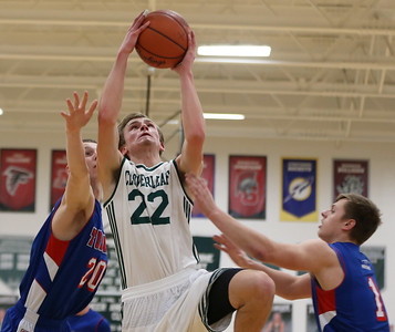Cloverleaf senior Ryan Gutschow scores between Tuslaw defenders Justin Carroll (L) and Chase Woods during the first half.  AARON JOSEFCZYK / GAZETTE