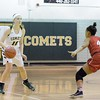 Amherst's Kamryn Dziak sets up against Elyria's Nayani Pope. JESSE GRABOWSKI / CHRONICLE