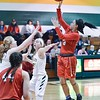 Elyria's Tristyn Thurman goes up for a shot Thursday at Amherst. JESSE GRABOWSKI / CHRONICLE