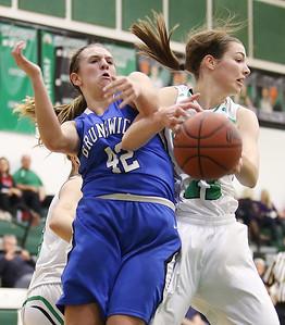 Highland's Marlee Profitt grabs a rebound against Brunswick's Paige Billetz during the first quarter. (RON SCHWANE / GAZETTE)