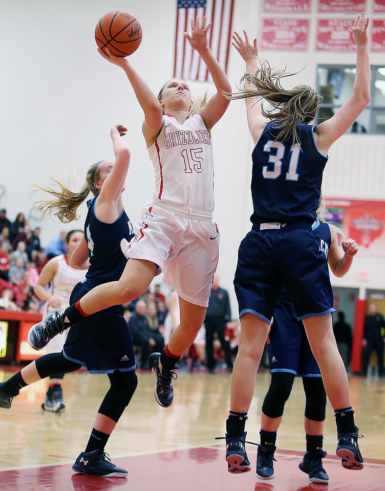 Wadsworth's Jodi Johnson goes up for a shot between Magnificat's Lily Schwind, right, and Abigail Adler during the second quarter. (RON SCHWANE / GAZETTE)