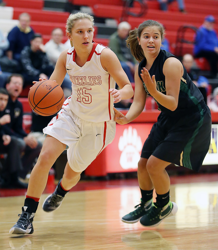 Wadsworth's Jodi Johnson drives past GlenOak's Mikayla Vance during the first quarter. (RON SCHWANE / GAZETTE)