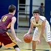 Avon Lake's Andrew Butrey guards Olmsted Falls' Michael Fritz Friday night. JESSE GRABOWSKI / CHRONICLE