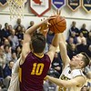Avon Lake's Nate Sidloski is met with a tough defense from Olmsted Falls Friday night. JESSE GRABOWSKI / CHRONICLE
