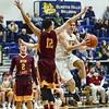Avon Lake's Jordan Ball (12) goes up to block Olmsted Falls' Eric Hanna. JESSE GRABOWSKI / CHRONICLE