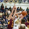 Olmsted Falls' Braden Galaska (23) goes up as Avon Lake's Cole Schraff (5) attempts to block. JESSE GRABOWSKI / CHRONICLE