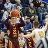 Avon Lake's Nick Marsh looks to pass to a teammate Friday in their 55-39 loss to Olmsted Falls. JESSE GRABOWSKI / CHRONICLE