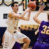 Olmsted Falls' Eric Hanna finds a tough defense in their game against Avon Friday night. JESSE GRABOWSKI / CHRONICLE