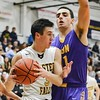 Avon's Vlasi Pappas plays tough defense against Eric Hanna of Olmsted Falls Friday. JESSE GRABOWSKI / CHRONICLE