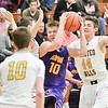 Avon's Jacob Chasteen makes hs way to the basket in their 70-67 win against Olmsted Falls. JESSE GRABOWSKI / CHRONICLE