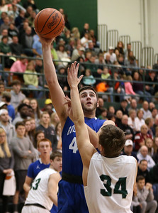 Brunswicks's Zak Zografos puts up a shot over Medina's Samuel McKee during the first half. AARON JOSEFCZYK / GAZETTE