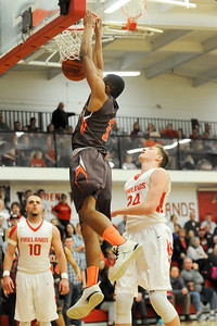 Buckeye's Justin Canedy dunks the ball after getting fouled by Fireland's Richard Maggard in the second quarter Friday night at Firelands High School. JUDD SMERGLIA / GAZETTE
