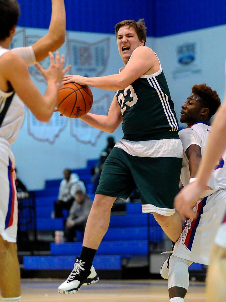 Cloverleaf's Matthew Tanko #23 looks to pass the ball as he is defended by Ravenna's Kymani Jones #5 during Friday's game at Ravenna High School. (NICK CAMMETT/GAZETTE)