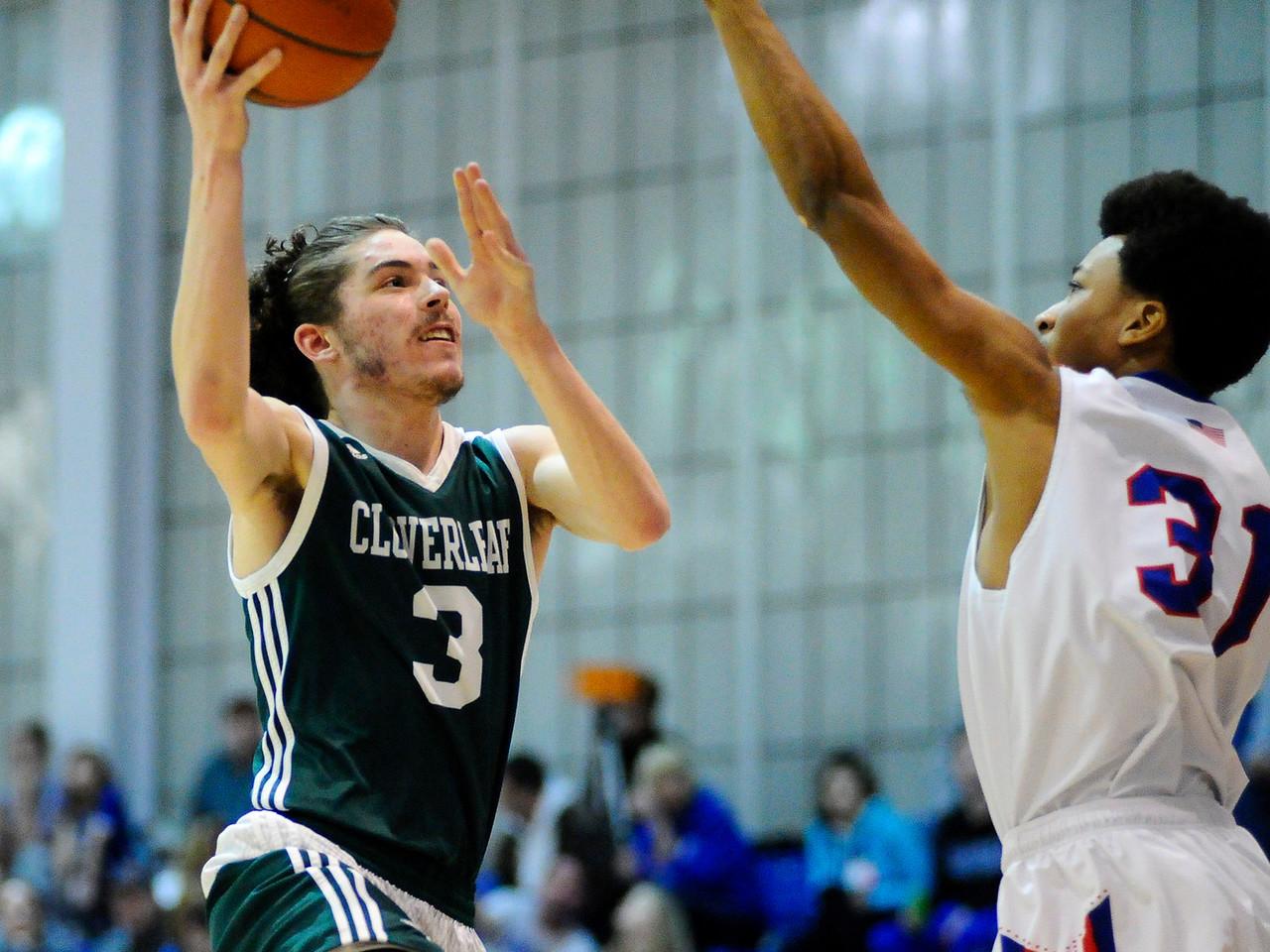Cloverleaf's Tyler Kapeluck #3 drives to the basket during Friday's game against Ravenna at Ravenna High School. (NICK CAMMETT/GAZETTE)