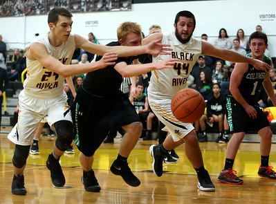 Black River's River Wheeler and Curtis Roupe battle Columbia's Caleb Elsesser for a loose ball during the first quarter. AARON JOSEFCZYK / GAZETTE