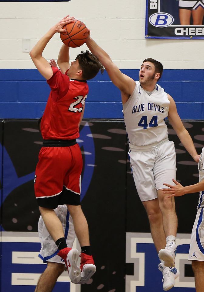 Brunswick's Zak Zografos blocks the shot of Elyria's Josh Lotko during the first quarter. AARON JOSEFCZYK / GAZETTE
