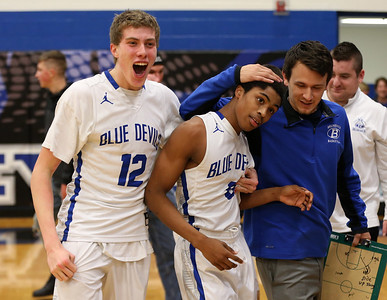 Brunswick's Keith Simmons is celebrates with coach Anthony Ocacio and Alex Wyatt after scoring as time expired to defeat Elyria 43-41. AARON JOSEFCZYK / GAZETTE