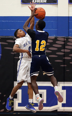 Brunswick's Keith Simmons attempts to block the shot or Euclid's Garvin Clarke during the second quarter. AARON JOSEFCZYK / GAZETTE