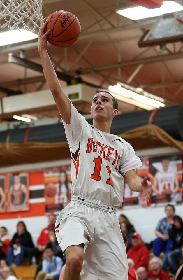 Buckeyes' Joey Bartinelli lays the ball in for two during the first half of the Bucks game against Firelands. AARON JOSEFCZYK / GAZETTE