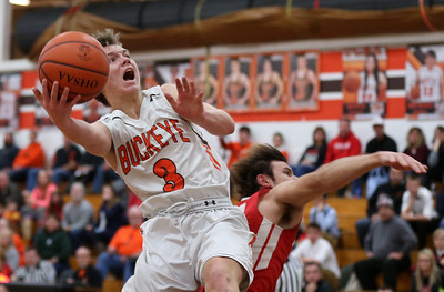 Buckeyes' Mike Novick puts up a shot after being fouled by Firelands Clayton Lucki during the first half. AARON JOSEFCZYK / GAZETTE