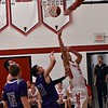 Firelands' Nicholas Denney shoots for 2 durring their game against Keystone Friday night. JESSE GRABOWSKI / CHRONICLE