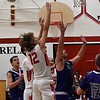 Patrick Brightbill shoots durring their game against Keystone Friday. JESSE GRABOWSKI / CHRONICLE