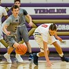 North Ridgeville's Josh Harp (left) and Oberlin's Greg Richardson scramble for a loose ball Friday in Vermilion. JESSE GRABOWSKI / CHRONICLE