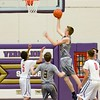 North Ridgeville's Zach Perkins puts up 2 points. JESSE GRABOWSKI / CHRONICLE