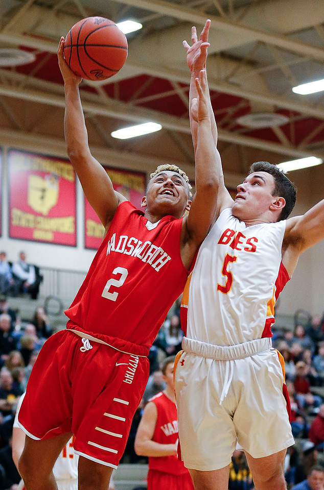 Wadsworth's Tony Hewitt shoots over Brecksville's Matt Dimitrijevs during the first quarter. (RON SCHWANE / GAZETTE)