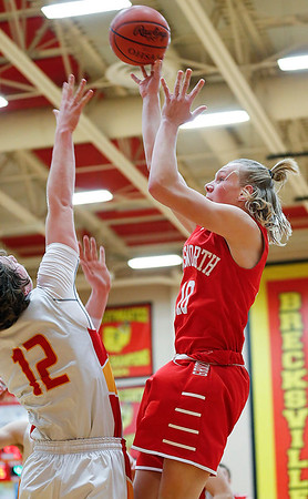 Wadsworth's Jack Simmons shoots over Brecksville's Mike Rose during the second quarter. (RON SCHWANE / GAZETTE)