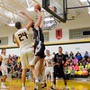 Wellington's Maxwell Joppeck goes up for points over Black River. JESSE GRABOWSKI / CHRONICLE
