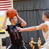 Wellington's Brandon Orozco looks to pass over Black River Senior Zach Hawley Friday night. JESSE GRABOWSKI / CHRONICLE