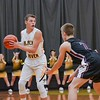 Black River's Zach Hawley is guarded by Wellington's Ryan Whitaker (2). JESSE GRABOWSKI / CHRONICLE