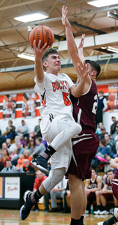 Buckeye's Braeden Stauffer shoots against Wellington's Josh Kindel during the second quarter. (RON SCHWANE / GAZETTE)