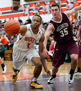 Buckeye's Justin Canedy chases down a rebound against Wellinton's Trey Bealer during the second quarter. (RON SCHWANE / GAZETTE)