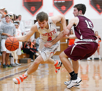 Buckeye's Michael Novick drives around Wellington's Trevor Porter during the second quarter. (RON SCHWANE / GAZETTE)