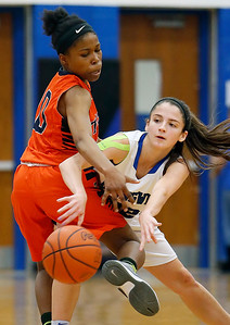 Brunswick's Eileen Salisbury passes around Berea-Midpark's Jada Marone during the second quarter. (RON SCHWANE / GAZETTE)