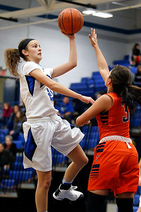 Brunswick's Olivia Andrew shoots over Berea-Midpark's Jasmine Kinsey during the first quarter. (RON SCHWANE / GAZETTE)
