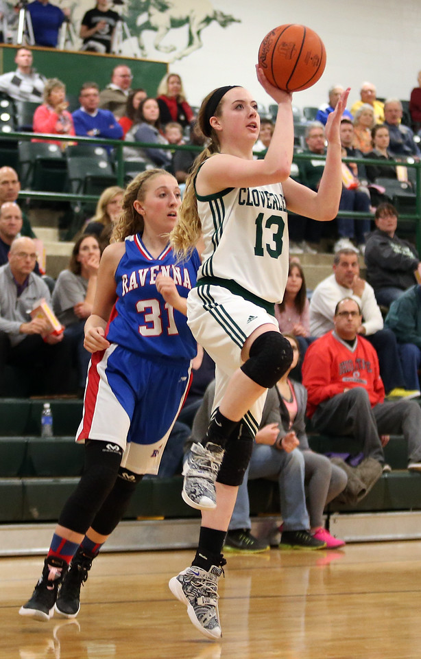 Cloverleaf senior Lexi Civittolo gets past Ravenna defender Emily Holt to put up a shot for two during the first half. AARON JOSEFCZYK/GAZETTE