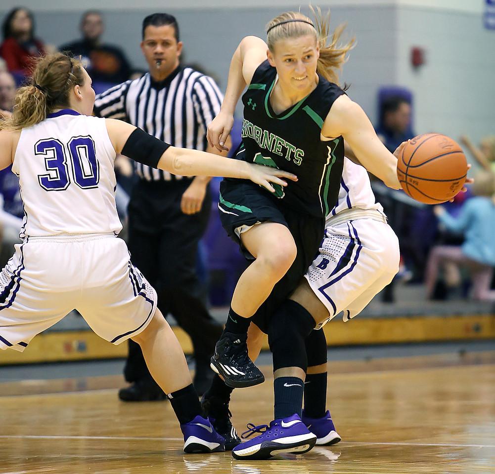 Highland's Madison Less splits Barberton's Brooke Lee (30) and Savannah Blackwell during the first quarter. (RON SCHWANE / GAZETTE)