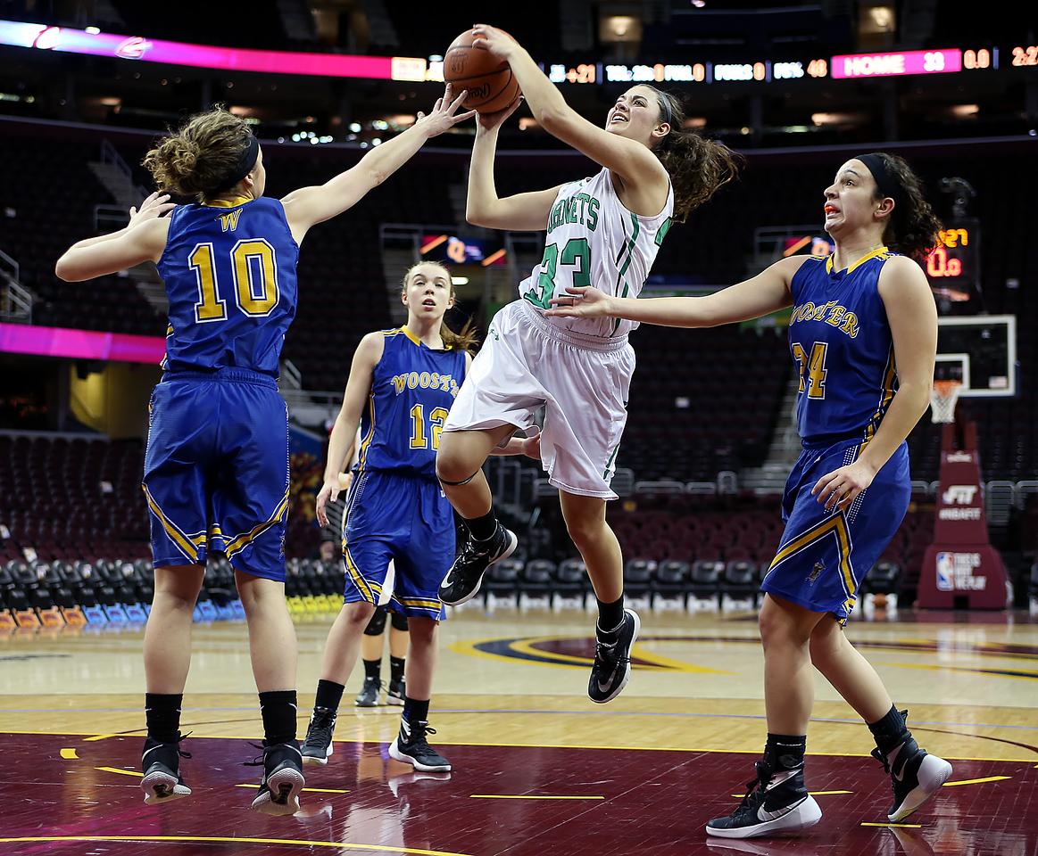 Highland's Kathleen Kirchner goes for a shot against Wooster's Halle Kotulock (10), Sydney Clapp (12) and Carla Stoll during the second quarter at Quicken Loans Arena. (RON SCHWANE / GAZETTE)