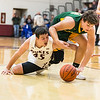 Wellington's Max Joppeck hits the floor to try to keep the ball away from Amherst's Matt Fairchild during Thursday night's game at the Gossman Insurance Holiday Tournament at Wellington High School. Joppeck scored 33 points and grabbed 11 rebounds to lead Wellington to a 75-58 win. JOE COLON / CHRONICLE
