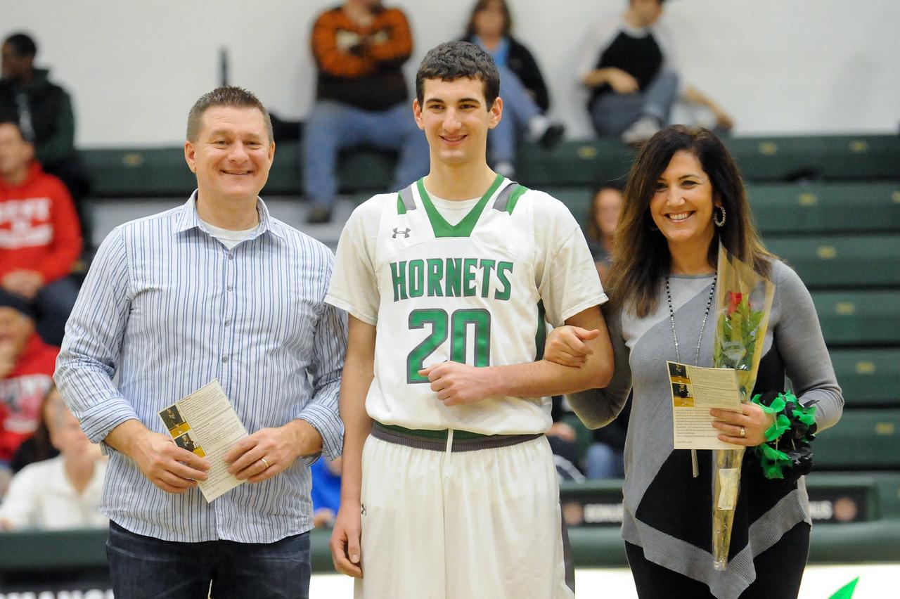 Highland Senior basketball player Brandon Shaw is recognized along with his parents Karolyn and Tom Shaw Friday night at Highland's Senior Night. JUDD SMERGLIA/GAZETTE
