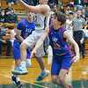 Elyria Catholic's David Griffin goes to the hoop past Bay's Brent Hull Jan. 19. STEVE MANHEIM / CHRONICLE