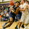 Lorain's Jordan Jackson tries to drive past Vermilion's Reese Miller during Tuesday's game at Vermilion. Jackson hit the game-winning free throw with three second to play. JOE COLON / CHRONICLE