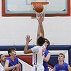 Aaron Hopkins (15) goes up for points over Open Door's Jared Bublinec. JESSE GRABOWSKI / CHRONICLE