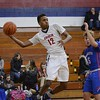 Oberlin's Darian Taylor passes to a teammate Tuesday  against Open Door. JESSE GRABOWSKI / CHRONICLE