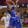 Open Door's RJ Stanford goes up for points Tuesday at Oberlin. JESSE GRABOWSKI / CHRONICLE