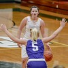 Olmsted Falls' Clare Kelly eyes the basket as she is guarded by Avon's Karlee Clement. JESSE GRABOWSKI / CHRONICLE